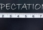 Tape measure aligned against the word expectations